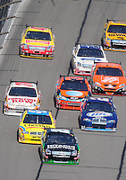 Sept. 28, 2008; Kansas City, KS, USA; Nascar Sprint Cup Series driver Travis Kvapil (28) leads a pack of cars during the Camping World RV 400 at Kansas Speedway. Mandatory Credit: Mark J. Rebilas-