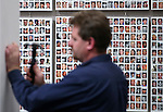 A worker hangs pieces of the &quot;Always Lost: A Meditation on War&quot; exhibit at the Legislative Building in Carson City, Nev., on Thursday, April 2, 2015. Framed by the &quot;Wall of the Dead,&quot; including images and names of nearly 7,000 U.S. military war casualties in Iraq and Afghanistan since Sept. 11, 2001, the exhibit will be open April 6-22.<br /> Photo by Cathleen Allison