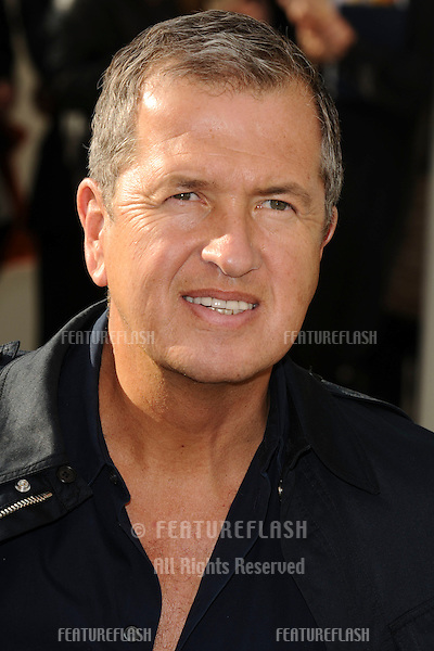 Mario Testino arriving for the Burberry fashion show as part of London Fashion Week at the Chelsea College of Art and Design, London.  22/09/2010  Picture by: Steve Vas / Featureflash