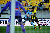 Sydney's Joshua Brilliante holds off Wellington's Alex Rufer during the A-League football match between Wellington Phoenix and Sydney FC at Westpac Stadium in Wellington, New Zealand on Saturday, 23 December 2017. Photo: Dave Lintott / lintottphoto.co.nz