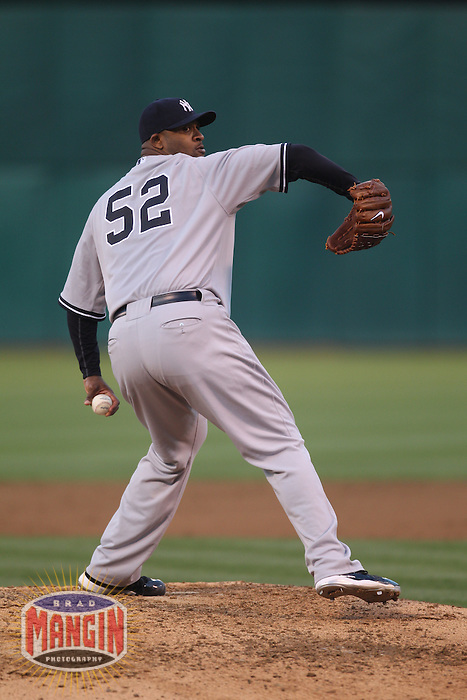 OAKLAND, CA - JULY 6:  CC Sabathia #52 of the New York Yankees pitches against the Oakland Athletics during the game at the Oakland-Alameda County Coliseum on July 6, 2010 in Oakland, California. Photo by Brad Mangin