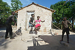 Sisters Erm Jouna Dalmas and Iznaida Dalmas jump rope together in front of their family's new home in Picmy, a village on the Haitian island of La Gonave where Service Chr&eacute;tien d&rsquo;Ha&iuml;ti is working with survivors of Hurricane Matthew, which struck the region in 2016. Holding the rope are their brothers Vestander and Dwendy.<br /> <br /> SCH, a member of the ACT Alliance, is helping families like this one repair or rebuild their homes on the island.<br /> <br /> Parental consent obtained.