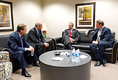 United States President George W. Bush meets with, from left, William Clay Ford Jr., Chairman & CEO of Ford Motor Company; Dieter Zetsche, President & CEO of Chrysler Group; and Richard Wagoner, President & CEO of General Motors Corporation, at the Ford Community and Performing Arts Center in Dearborn, Michigan, Monday, April 28, 2003.<br /> Mandatory Credit: Tina Hagar / White House via CNP