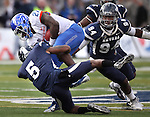 Boise State's Jay Ajayi (27) runs up the middle against Nevada defenders Duke WIlliams (5) and Lenny Jones (94) during the second half of an NCAA college football game on Saturday, Dec. 1, 2012,  in Reno, Nev. Boise State won 27-21. (AP Photo/Cathleen Allison)