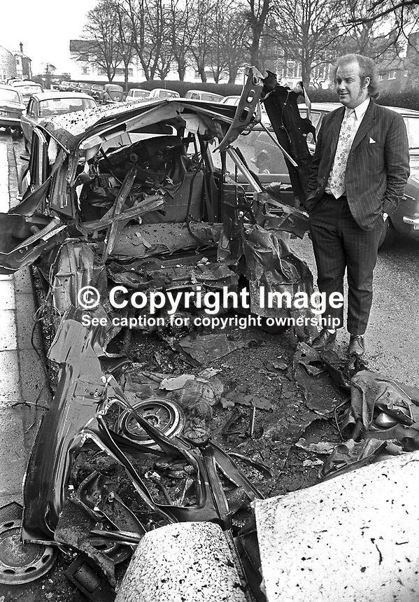 Ivan Cooper, SDLP MP for Mid-Derry, with the remains of his car which was blown up outside his home. NI Troubles. Explosion. Ref: 19720330001.<br /> <br /> Copyright Image from Victor Patterson, 54 Dorchester Park, <br /> Belfast, UK, BT9 6RJ<br /> <br /> t1: +44 28 9066 1296 (from Rep of Ireland 048 9066 1296)<br /> t2: +44 28 9002 2446 (from Rep of Ireland 048 9002 2446)<br /> m: +44 7802 353836<br /> <br /> e1: victorpatterson@me.com<br /> e2: victorpatterson@gmail.com<br /> www.victorpatterson.com<br /> <br /> Please see my Terms and Conditions of Use at www.victorpatterson.com. It is IMPORTANT that you familiarise yourself with them.<br /> <br /> Images used on the Internet must be visibly watermarked i.e. &copy; Victor Patterson<br /> within the body of the image and copyright metadata must not be deleted. Images <br /> used on the Internet have a size restriction of 4kbs and will be chargeable at current<br />  NUJ rates unless agreed otherwise.<br /> <br /> This image is only available for the use of the download recipient i.e. television station, newspaper, magazine, book publisher, etc, and must not be passed on to any third <br /> party. It is also downloaded on condition that each and every usage is notified within 7 days to victorpatterson@me.com<br /> <br /> The right of Victor Patterson to be identified as the author is asserted in accordance with The Copyright Designs And Patents Act (1988).