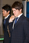 """Japan national football team, Atsuto Uchida, Gotoku Sakai, June 27, 2014, Chiba, Japan - (L to R) Atsuto Uchida and Gotoku Sakai arrive at Narita International Airport with other members of the Japan national football team. Members of the Japan national football team arrives at Narita with a disappointed look on their faces. They couldn't advance to the final 16 in """"2014 FIFA World Cup Brazil"""" and came back earlier. (Photo by Rodrigo Reyes Marin/AFLO)"""