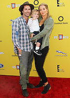 SANTA MONICA, CA, USA - NOVEMBER 16: Greg Lauren, Sky Lauren, Elizabeth Berkley arrives at the P.S. ARTS Express Yourself 2014 held at The Barker Hanger on November 16, 2014 in Santa Monica, California, United States. (Photo by Celebrity Monitor)
