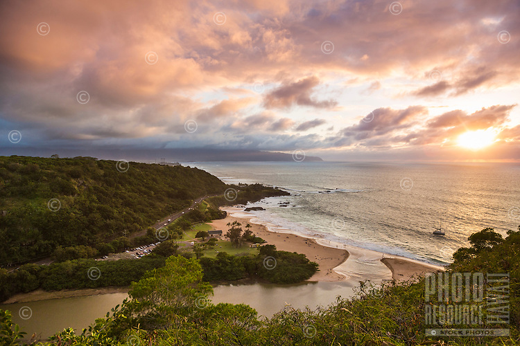 Waimea Bay Beach Park at sunset as seen from Pupukea, with Kaena Point in the background, O'ahu.