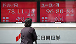 June 4, 2012, Tokyo, Japan - A pedestrian checks the foreign exchange quotes as the U.S. dollar is traded in the lower 78-yen level, left, and the euro in the upper 98-yen mark on the Tokyo foreign exchange market Monday morning, June 4, 2012. The dollar briefly hit a three-and-a-half month low and the European unit dipped to the lowest in 11 and half years. (Photo by Natsuki Sakai/AFLO) AYF -mis-