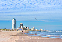 We capture this seascape of South Padre Island last winter at the Texas seashore where you can see some families enjoying the texas coast in winter.  You can also see the south padre skyline made up of high rise condos and hotel as far as the eye can see.
