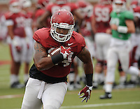 NWA Democrat-Gazette/ANDY SHUPE<br /> Arkansas running back Kody Walker carries the ball Tuesday, Aug. 18, 2015, during practice at the university's practice field in Fayetteville.