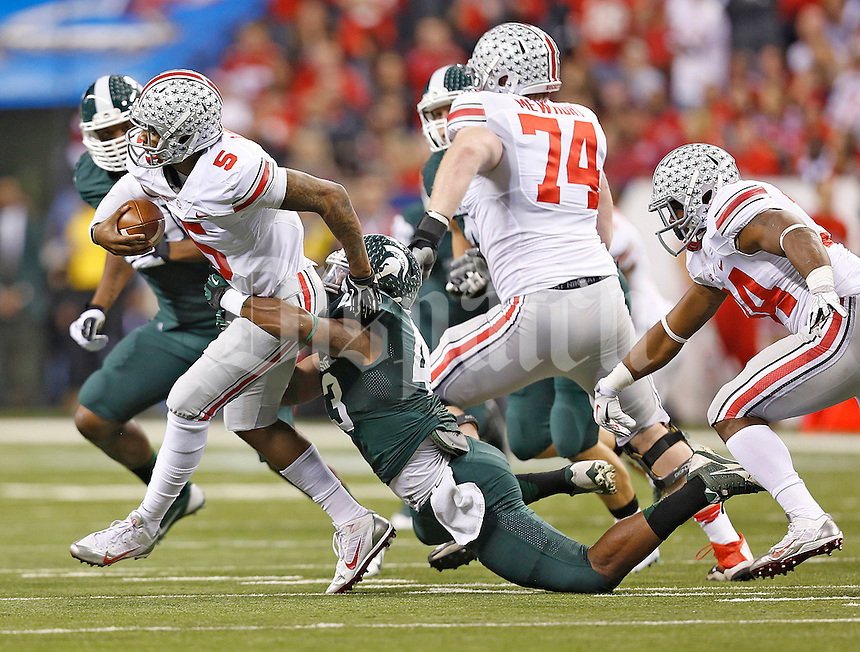 Ohio State Buckeyes quarterback Braxton Miller (5) is taken down by Michigan State Spartans linebacker Ed Davis (43) in first half play at Lucas Oil Stadium in Indianapolis, Ohio on December 7, 2013.  (Chris Russell/Dispatch Photo)