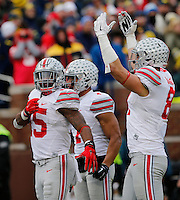 Ohio State Buckeyes running back Ezekiel Elliott (15) celebrates scoring a touchdown with tight end Nick Vannett (81) and wide receiver Jalin Marshall (7) during the fourth quarter of the NCAA football game at Michigan Stadium in Ann Arbor on Nov. 28, 2015. Ohio State won 42-13. (Adam Cairns / The Columbus Dispatch)