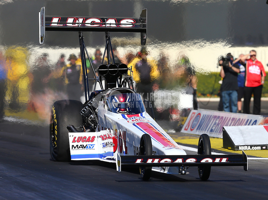 Feb 12, 2016; Pomona, CA, USA; NHRA top fuel driver Richie Crampton during qualifying for the Winternationals at Auto Club Raceway at Pomona. Mandatory Credit: Mark J. Rebilas-USA TODAY Sports
