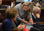 Nevada Sens. Debbie Smith, D-Sparks, left, and Barbara Cegavske, R-Las Vegas, work on the Senate floor during a special Legislative session in Carson City, Nev., on Tuesday, June 4, 2013. Gov. Brian Sandoval called lawmakers into a special session after they missed meeting their end of session deadline by several minutes. (AP Photo/Cathleen Allison)