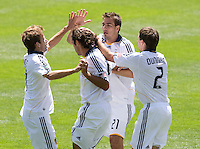 20 June 2009: (left to right) Galaxy players' Mike Magee, Alan Gordon and Todd Dunivant celebrate with Jovan Kirovski of the Galaxy after Kirovski scored a goal during the second half of the game at Oakland-Alameda County Coliseum in Oakland, California.   Earthquakes defeated Galaxy at 2-1.