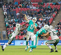 04.10.2015. Wembley Stadium, London, England. NFL International Series. Miami Dolphins versus New York Jets. Miami Dolphins Quarterback Ryan Tannehill throws the ball down field during the final moments of the fourth quarter.
