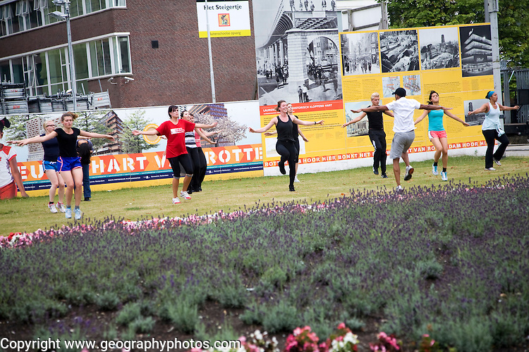 A group of people mainly women taking part in an outdoor fitness physical exercise class, Rotterdam, Netherlands