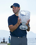 Tony Romo holds up the trophy after winning the American Century Championship at Edgewood Tahoe Golf Course in Stateline, Nevada, Sunday, July 15, 2018.