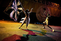 Rocinha samba school dancers, mestre-sala (the master dancer) and porta-bandeira (the flag bearer lady), rehearse their Carnival dance act in front of the school's workshop in Rio de Janeiro, Brazil, 15 February 2012.