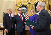 Seven Mnuchin, accompanied by his fiancee Louise Linton, is sworn-in as Treasury Secretary by Vice President Mike Pence while President Donald Trump watches, during a ceremony at the White House in Washington, D.C. on February 13, 2017. Mnuchin was confirmed by the Senate 54-47. <br /> Credit: Kevin Dietsch / Pool via CNP