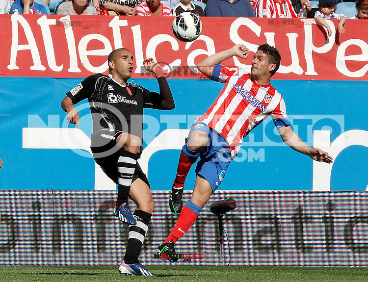 Atletico de Madrid's Koke (r) and Granada's Carlos Reina Aranda during La Liga match.April 14,2013. (ALTERPHOTOS/Acero)