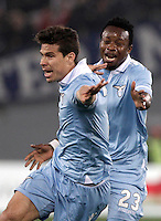 Calcio, Serie A: Roma vs Lazio. Roma, Stadio Olimpico, 8 aprile 2013..Lazio midfielder Hernanes, of Brazil, celebrates with teammate Ogenyi Onazi, of Nigeria, right, after scoring during the Italian serie A football match between A.S. Roma  and Lazio at Rome's Olympic stadium, 8 april 2013..UPDATE IMAGES PRESS/Isabella Bonotto