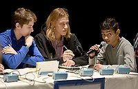 NWA Democrat-Gazette/DAVID GOTTSCHALK Alec Gilmore (from left), a sophomore at Bentonville High School, Beck Perry, a sophomore, watch as Shivabalan (cq) Balathandayuthapani (cq), a freshman, answers a question Tuesday, March 12, 2019, during a semi-final round of the ACE  match in the Fine Arts Building at Farmington High School. Bentonville competed against Prairie Grove High School in the first round.