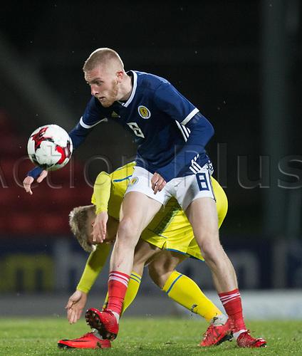 14th November 2017, McDiarmid Park, Perth, Scotland; UEFA Under 21 European Championships qualification, Scotland U-21 versus Ukraine U-21; Scotland's Oliver McBurnie battles for the ball with Ukraine's Pavlo Lukyanchuk
