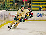 17 December 2013:  University of Vermont Catamount Defenseman Nick Bruneteau, a Senior from Omaha, NB, starts a play from his own end during the first period against the Northeastern University Huskies at Gutterson Fieldhouse in Burlington, Vermont. The Huskies shut out the Catamounts 3-0 to end UVM's 5 game winning streak. Mandatory Credit: Ed Wolfstein Photo *** RAW (NEF) Image File Available ***