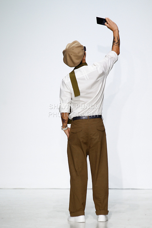 Fashion designer  Bumuk Choi takes a selfie on the runway at the close of his General Idea Spring Summer 2018 collection fashion show, at Skylight Clarkson Square on July 13, 2017; during New York Fashion Week: Men's Spring Summer 2018.