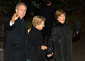 United States President George W. Bush, left, Jenna Welsh, mother of Laura Bush, center, and first lady Laura Bush depart the White House to spend Christmas at Camp David at the White House in Washington, DC on December 22, 2003.<br /> Credit: Ron Sachs / CNP