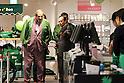 December 9, 2016, Tokyo, Japan - Japan's largest supermarket chain Aeon president Motoya Okada and French organic food supermarket Bio C'Bon founder Thierry Brissaud (L) inspect Japan's fisrt Bio C'Bon supermarket in Tokyo on Friday, December 9, 2016.  French organic food supermarket Bio C'Bon and French frozen food maker Picard opened their shop with Aeon group. (Photo by Yoshio Tsunoda/AFLO) LWX -ytd-