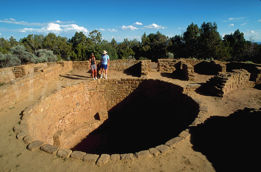 Couple visiting the Anasazi ruins at Mesa Verde. Colorado.