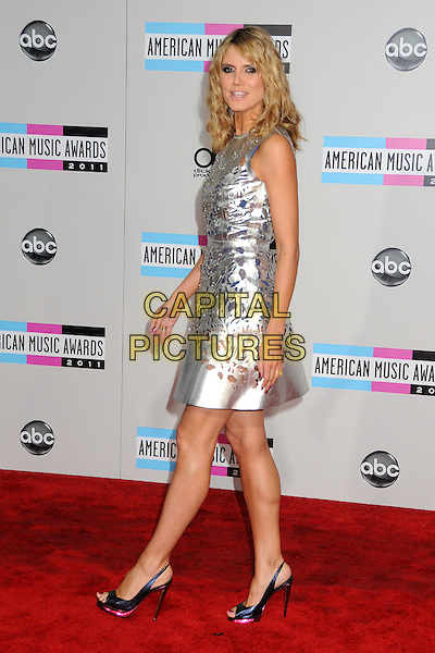 Heidi Klum.2011 American Music Awards - Arrivals held at Nokia Theatre LA Live, Los Angeles, California, USA..November 20th, 2011.ama amas ama's full length silver sleeveless silk satin perforated dress cut out away pattern open toe shoes black side .CAP/ADM/BP.©Byron Purvis/AdMedia/Capital Pictures.