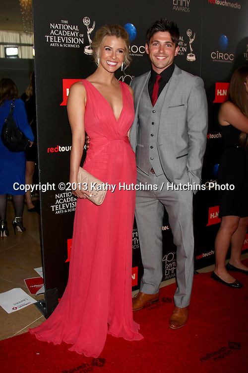 LOS ANGELES - JUN 16:  Linsey Godfrey, Robert Adamson arrives at the 40th Daytime Emmy Awards at the Skirball Cultural Center on June 16, 2013 in Los Angeles, CA