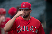 AZL Angels catcher Brett Bond (10) walks the dugout after his professional pitching debut during the completion of a suspended Arizona League game against the AZL Diamondbacks at Tempe Diablo Stadium on July 16, 2018 in Tempe, Arizona. The game was a continuation of the July 11, 2018 contest that was suspended by rain in the middle of the eighth inning. The AZL Diamondbacks defeated the AZL Angels 12-8. (Zachary Lucy/Four Seam Images)