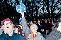 """A woman holds a thumbs-up hand reading """"Make America Great Again!"""" while watching the Make America Great Again! Welcome Celebration honoring soon-to-be president Donald Trump at the Lincoln Memorial in  Washington, D.C., on Thurs., Jan. 19, 2017, the day before the presidential inauguration of Donald Trump. The event had musical performances, speeches, and an appearance by Trump and his family."""