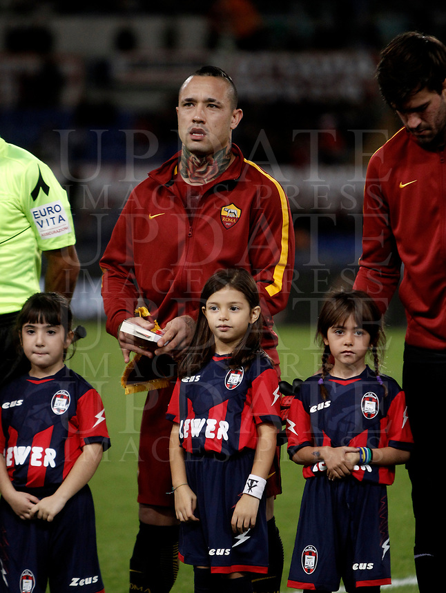 """Calcio, Serie A: Roma, stadio Olimpico, 25 ottobre 2017.<br /> Roma's Radja Nainggolan holds the book of holocaust victim Anne Frank before the Italian Serie A football match between AS Roma and Crotone at Rome's Olympic stadium, October 25, 2017.<br /> Few days ago Lazio fans posted anti-semitic photos of Anne Frank in a Roma jersey in the stands of the Stadio Olimpico. The Italian football federation announced that there will be a minute's reflection on the Holocaust before every match and a passage read from """"The Diary of Anne Frank"""". At the same time referees and captains will hand out copies of the diary and Italian Jewish writer Primo Levi's memoir """"If This Is A Man"""".<br /> UPDATE IMAGES PRESS/Isabella Bonotto"""