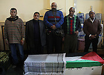 Egyptian artists gather around the body of Palestinian artist Ghassan Matar, 76, during his funeral, in cairo, Egypt on February 28, 2015. Photo by Amr Sayed