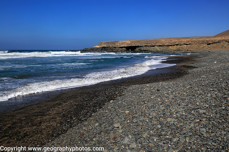 Waves breaking on beach at Playa de Garcey, Fuerteventura, Canary Islands, Spain