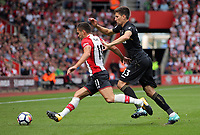 Dusan Tadic of Southampton is chased by Federico Fernandez of Swansea City  during the Premier League match between Southampton and Swansea City at the St Mary's Stadium, Southampton, England, UK. Saturday 12 August 2017