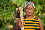 Paulia Guillaume stands on her farm in the Haitian community of Ganthier, where Mission Sociale des Eglises Hatiennes (MISSEH), a member of the ACT Alliance, has helped residents rebuild their lives after the village was devastated in 2016 by Hurricane Matthew. MISSEH has provided seeds and tools to farmers, including Guillaume, while helping the community organize a more agile and responsive program of disaster risk reduction.