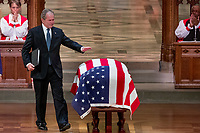 An emotional former President George Bush touches the flag-draped casket of his father, former President George H.W. Bush, after speaking during his State Funeral at the National Cathedral, Wednesday, Dec. 5, 2018, in Washington. <br /> Credit: Andrew Harnik / Pool via CNP / MediaPunch