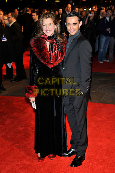 JANIE DEE & GUEST.'Me & Orson Welles'  UK film premiere at the Vue West End, Leicester Sqaure, London, England.18th November 2009..full length red fur collar jacket velvet jacket black long maxi grey gray suit scarf .CAP/PL.©Phil Loftus/Capital Pictures.
