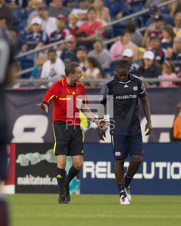 Referee verbally warns New England Revolution midfielder Shalrie Joseph (21). The New England Revolution defeated LA Galaxy, 2-0, at Gillette Stadium on July 10, 2010.