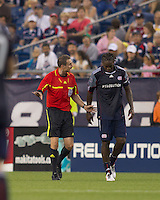 Referee verbally warns New England Revolution midfielder Shalrie Joseph (21). The New England Revolution defeated LA Galaxy, 2-0, at Gillette Stadium on July 10, 2010.