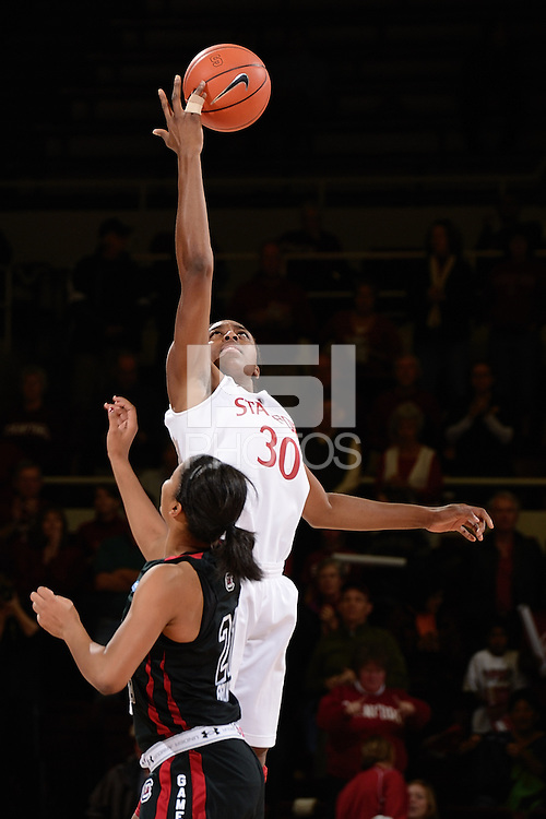 STANFORD, CA - NOVEMBER 26: Nnemkadi Ogwumike of Stanford women's basketball controls the initial tip-off in a game against South Carolina on November 26, 2010 at Maples Pavilion in Stanford, California.  Stanford topped South Carolina, 70-32.