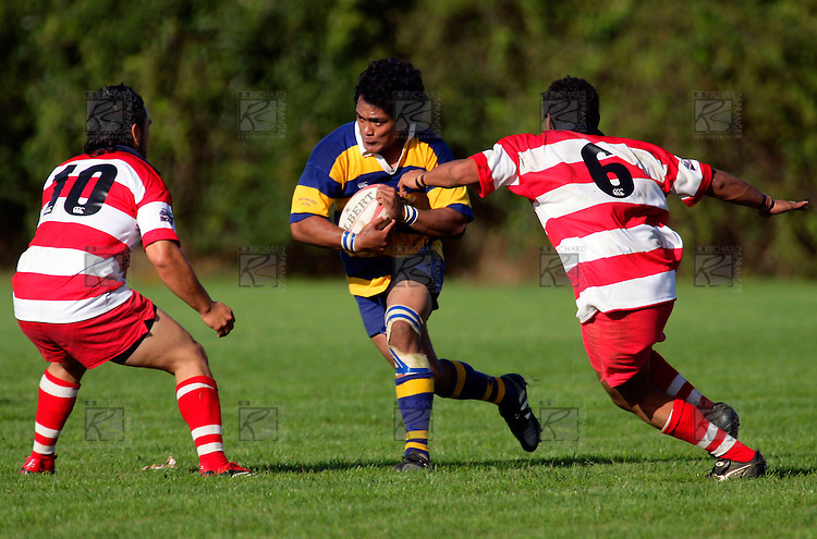 Patumahoe No 7 is all determination as he charges at Troy Nathan. Counties Manukau Premier Club Rugby, Patumahoe vs Karaka played at Patumahoe on Saturday 22nd April 2006. Karaka won 19 - 6.