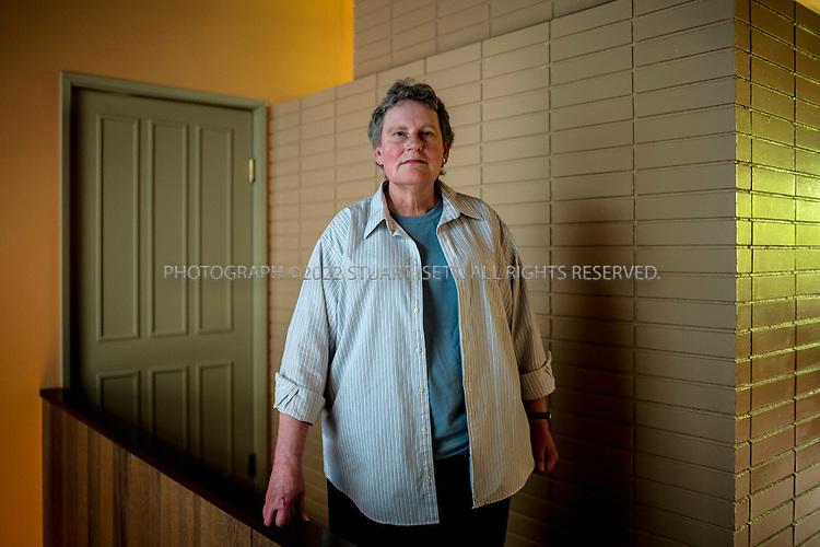 5/24/2015&mdash;Newcastle, WA<br /> <br /> SEC whistleblower Yolanda Holtzee, 59, in her home in Newcastle, WASH., near Seattle. <br /> <br /> Photograph by Stuart Isett for The Wall Street Journal.<br /> Slug: WHISTLEBLOWER